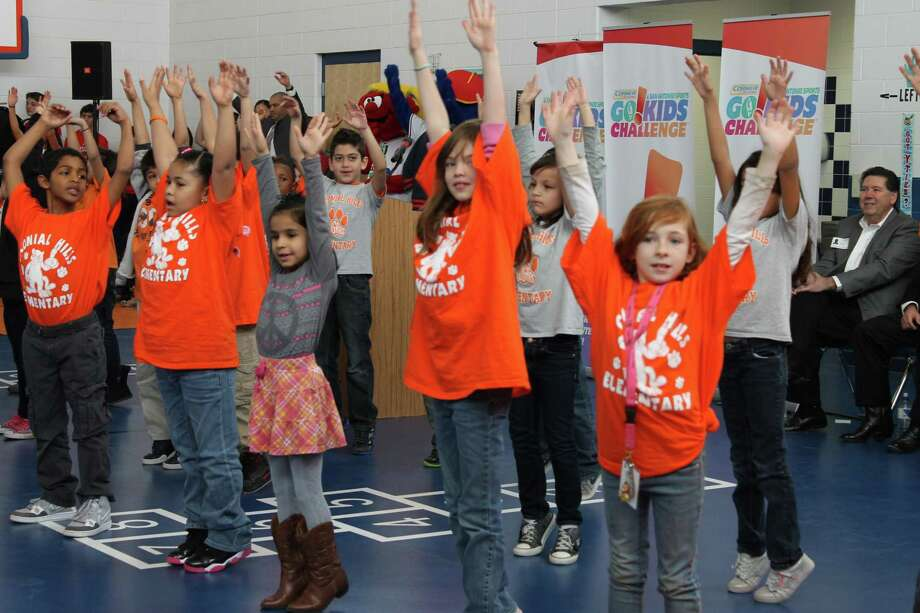 """Colonial Hills Elementary School second-graders at a """"shake it"""" dance to help kick off San Antonio Sports 2014 Corner Store Go!Kids Challenge in 2014, a program that encouraged exercise and discouraged sugary drinks. The school's many health initiatives put it among only 10 schools in the country to win a National Healthy Schools Gold Award this week. Photo: Courtesy Photo /Courtesy Photo"""