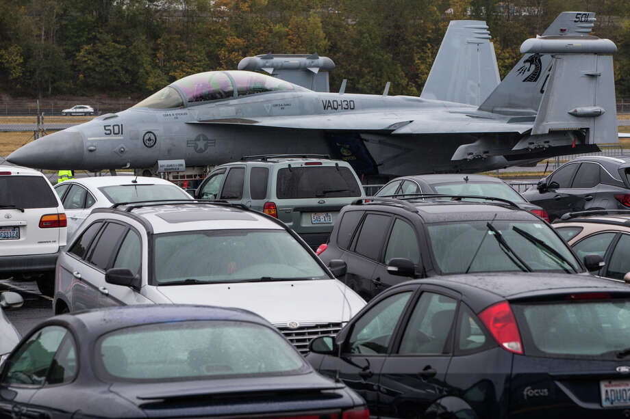 A Navy EA-18G Growler electronic attack jet double parks in the Museum of Flight's parking lot at Boeing Field on Thursday, Oct. 12, 2017. Photo: GRANT HINDSLEY, SEATTLEPI.COM / SEATTLEPI.COM