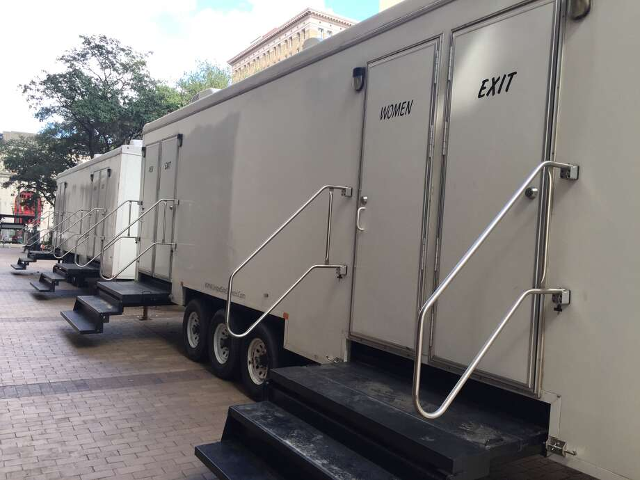 """Luxury"" bathroom trailers set up outside the Harris County Administration Building for prospective jurors."