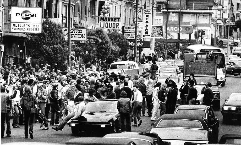 A crowd gathers in the Castro district in 1979 after a Pride parade: Decades later, reporter Jonathan Kauffman would show up to work at Ryan's Restaurant on 18th Street around the corner from Castro Street at the age of 24 and find a new kind of freedom and community. Photo: John Storey, San Francisco Chronicle