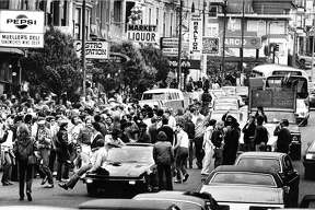 Castro Street in the Castro District June 22, 1979, residents gather after Pride parade