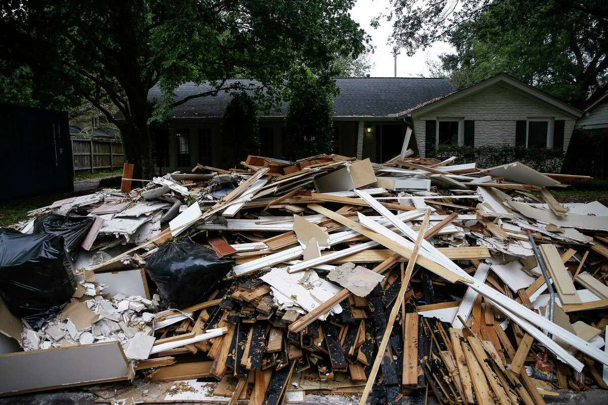 Flood debris is piled up outside a home on Grennoch Lane Tuesday, Oct. 10, 2017 in Bellaire.