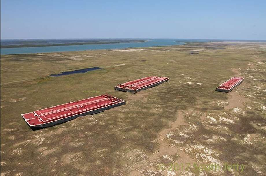 Six barges are stranded on San Jose Island, north of Port Aransas, following Hurricane Harvey. Photo: Courtesy/Port Aransas South Jetty, Dan Parker