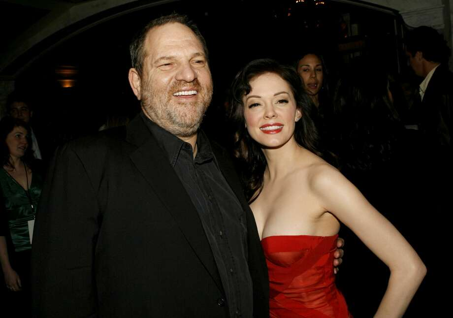 """Weinstein with Rose McGowan, who has accused him of rape. Through a spokesperson, Weinstein """"unequivocally denied"""" the allegations. Photo: Kevin Winter/Getty Images"""