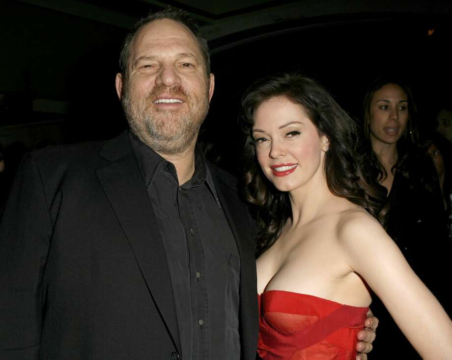 """FILE —Harvey Weinstein and Rose McGowan during """"Grindhouse"""" Los Angeles Premiere. Rose McGowan regained access to her Twitter account on Thursday following a temporary suspension by the social media platform for violating its terms of service. The actress has been a leading voice in recent days in criticizing Harvey Weinstein and those who failed to speak out against the Hollywood producer's past sexual abuse of women. Photo: Jeff Vespa/WireImage"""