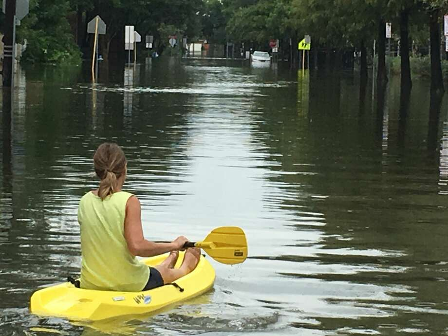 A Bellaire resident paddles along 3rd Street in the aftermath of Hurricane Harvey. Photo: Melissa Aguilar / Houston Chronicle