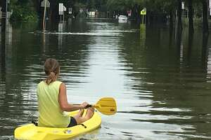 A Bellaire resident paddles along 3rd Street in the aftermath of Hurricane Harvey.