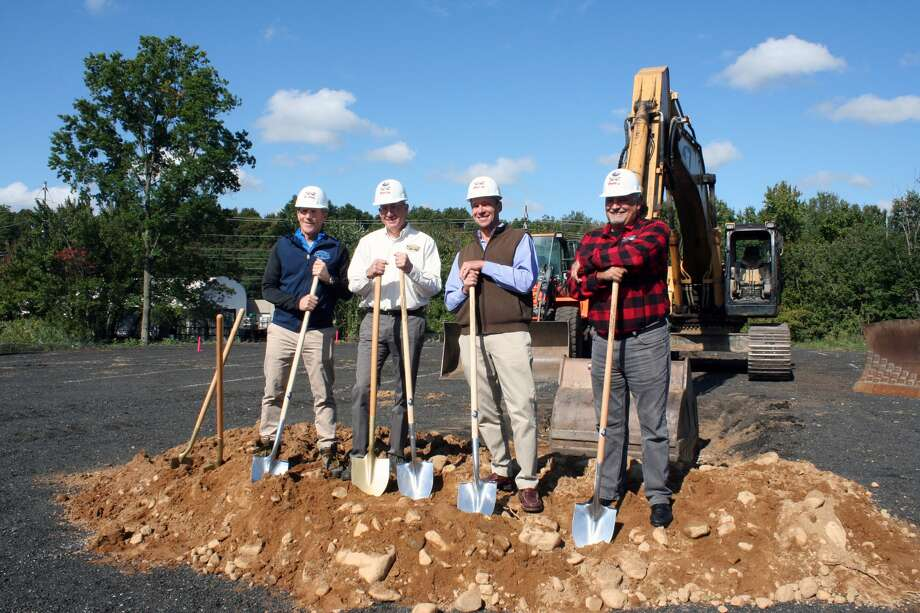 Two Roads Brewing Company founders (from left) Brad Hittle, Phil Markowski, Peter Doering and Clem Pellani oversee the groundbreaking of Area Two, a sour and barrel-aged brewing facility. Photo: Caitlin Mazzola Bagley, Hearst Connecticut Media Group
