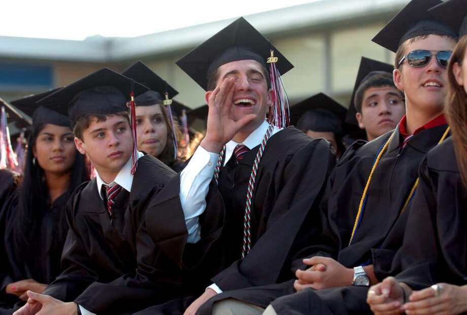 Highlights from Fairfield Warde's 6th Annual Commencement Exercises in Fairfield, Conn. on Thursday June 24, 2010. Graduate Filippo Cenatiempo cheers for a buddy getting his diploma. Photo: Christian Abraham / Connecticut Post