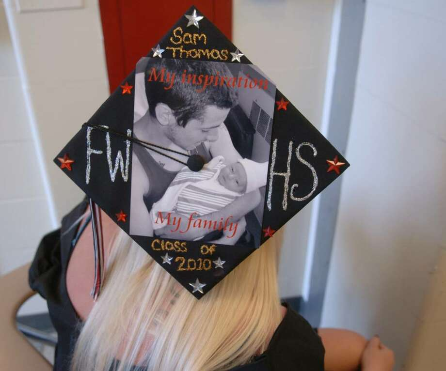 Fairfield Warde High School graduate Samantha Thomas shows off her mortar board showing the new baby she delivered June 8th. Her delivery date was supposed to be graduation day. Photo: Christian Abraham / Connecticut Post