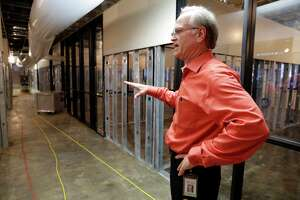 Director of facilities Eddie McFadden shows  offices, meeting rooms and labs inside the first floor of the Lone Star College-Kingwood campus library. Almost all of the library's books were lost in the flood.