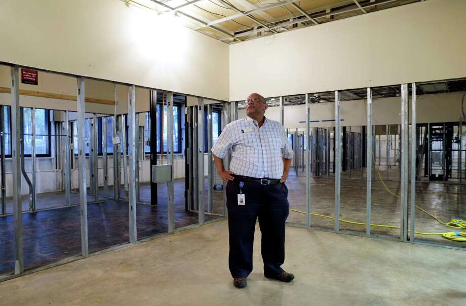Library director Anthony McMillan in what used to be his office on the first floor of the library building of the Lone Star College-Kingwood campus, where 95 percent of the books were lost due to flooding. Photo: Michael Wyke, Freelance / © 2017 Houston Chronicle