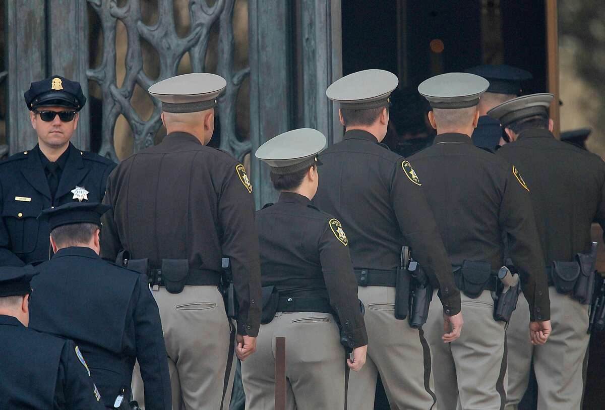 Members of the Las Vegas Metropolitan Police Department enter funeral services for Stacee Etcheber at St. Mary's Cathedral on Thursday, October 12, 2017, in San Francisco, Calif.