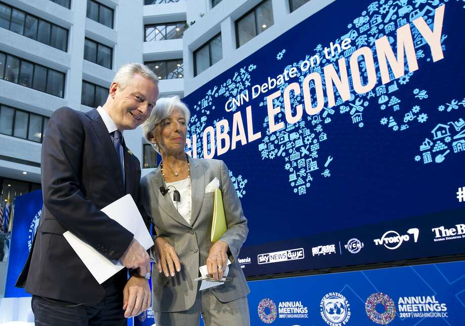 French Finance Minister Bruno Le Maire speaks with International Monetary Fund Managing Director Christine Lagarde during Thursday's session. Photo: Jose Luis Magana, Associated Press