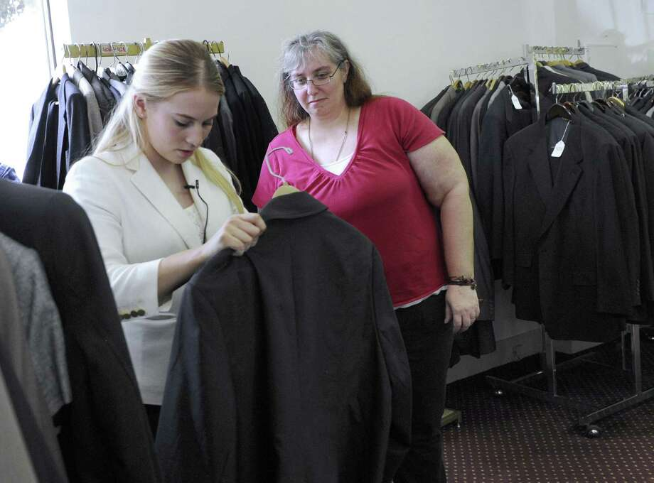 Cortney Schlogl, a marketing intern with Save-A-Suit helps Army veteran Venessea Anderson pick out a suit. Aspen Dental and Save-a Suit joined together to provide veterans with free dental work and a suit to wear on job interviews Tuesday, May 24, 2016. Photo: Carol Kaliff / Hearst Connecticut Media / The News-Times