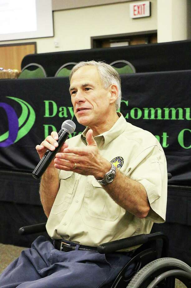 Gov. Greg Abbott speaks to the county leaders gathered for the quarterly Liberty County Economic Summit. The governor made a brief appearance during a presentation by the Texas Commission of Environmental Quality (TCEQ). Photo: David Taylor