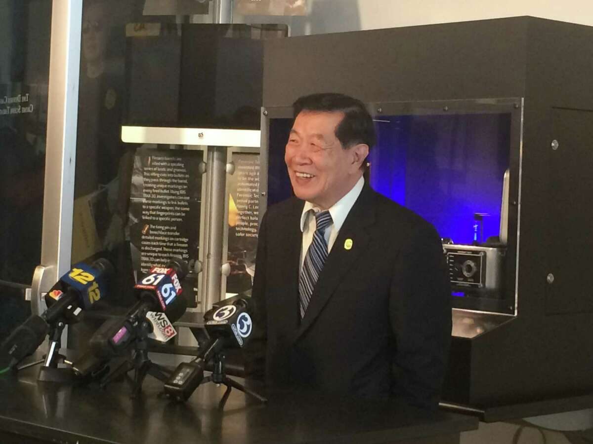 Henry C. Lee discusses the Las Vegas mass shooting with reporters in the entry hall of the Henry C. Lee College of Criminal Justice and Forensic Sciences at University of New Haven on Thursday.