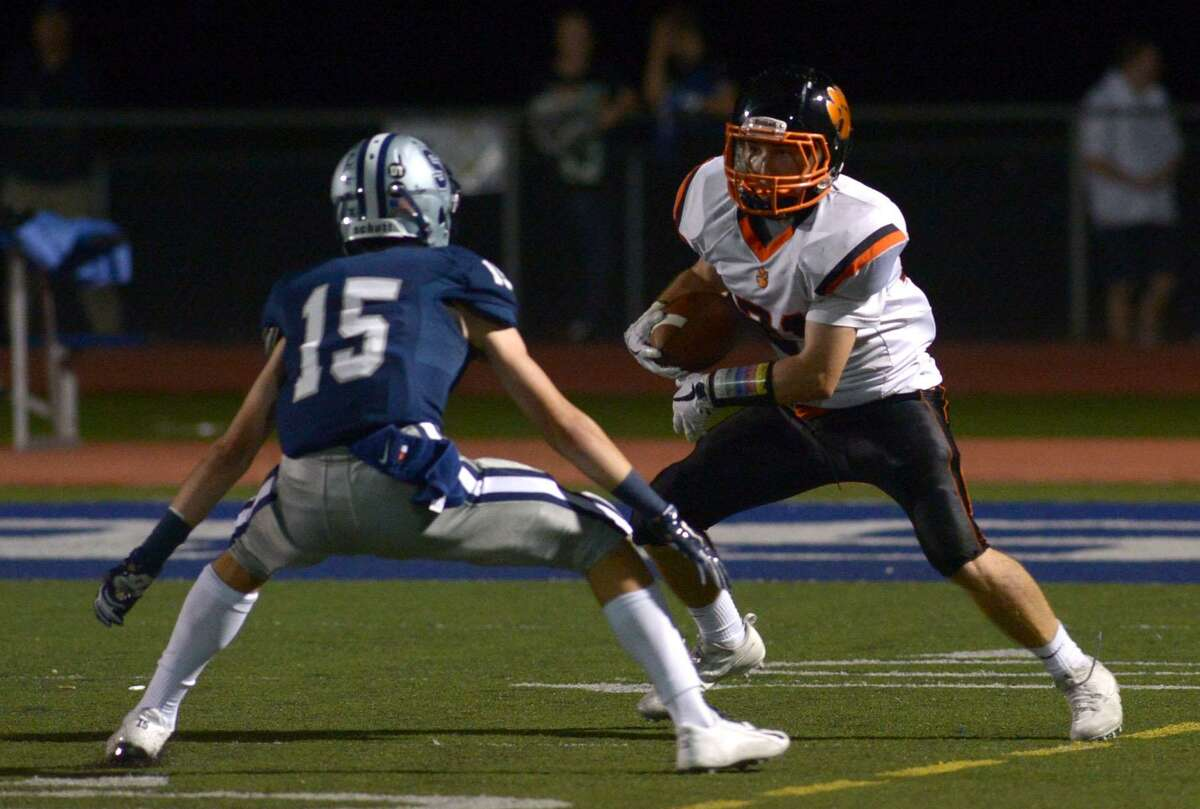 Ridgefield High School Tiger #21 Luke Gaydos looks for yardage during their football game against the Staples High School Wreckers Friday, October 6, 2017, in Westport, Conn.