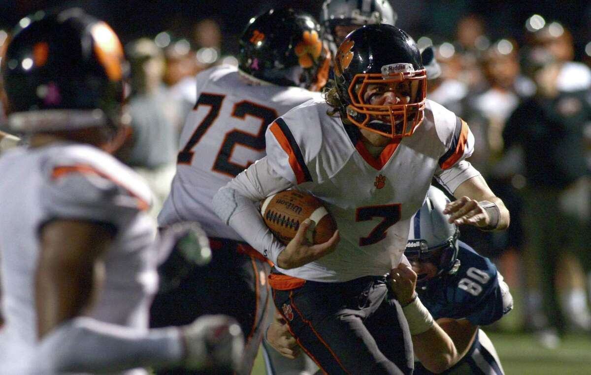 Ridgefield High School Tiger #7 Gregory Gatto runs for yardage during their football game against the Staples High School Wreckers Friday, October 6, 2017, in Westport, Conn.