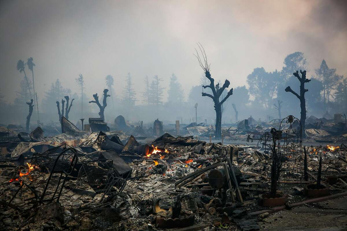 Le Roy and Donna Halbur, married for 50 years, died in the early hours of the Tubbs Fire as they tried to flee the flames. They were both 80. Above: Homes are seen burnt to the ground after a fire tore through the Journey's End mobile home park on Mendocino Avenue in Santa Rosa, Calif., on Monday, Oct. 9, 2017.