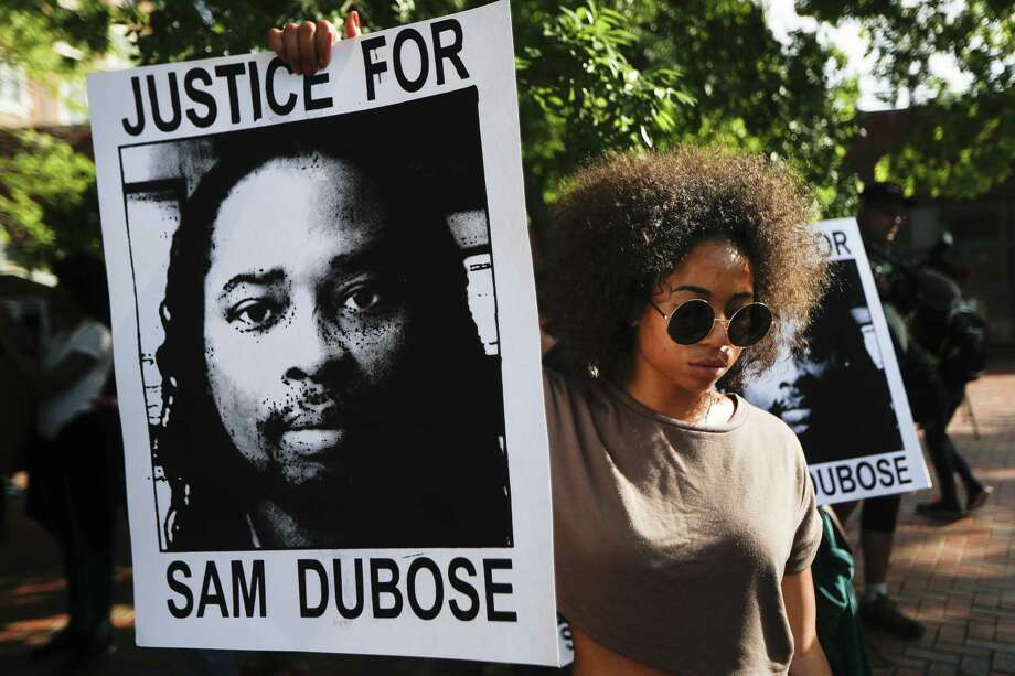 High profile cases tend to distort the figures. Racial bias is not rampant in the nation's police forces. Here, protesters June 28 demand that a white former police officer be tried a third time in the fatal shooting of an unarmed black motorist in Cincinnati. Photo: John Minchillo /Associated Press / AP