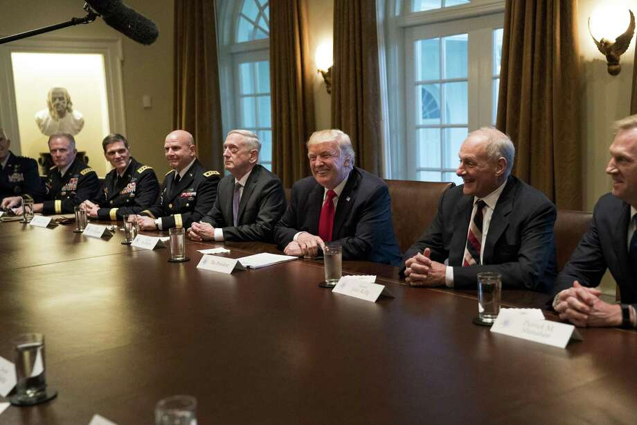 "When a nation has a president who must be ""contained"" on a daily basis by those around him, it must consider next steps. Here, Pesident Donald Trump at a meeting with senior military leaders in the Cabinet Room of the White House in Washington on Oct. 5. Photo: DOUG MILLS /NYT / NYTNS"