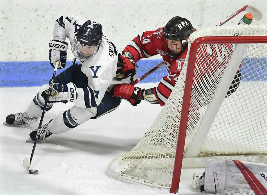 Yale sophomore left wing Joe Snively makes an attempt for a third goal in the third period as RPI freshman defenseman Will Reilly defends in a 7-3 win for the Bulldogs, Friday, December 9, 2016, at Ingalls Rink in New Haven. (Catherine Avalone/New Haven Register) Photo: Catherine Avalone / New Haven RegisterThe Middletown Press