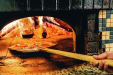 Pizza goes in Mediterraneo Restaurant's brick oven.