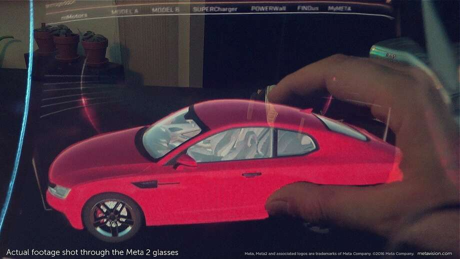 A view from Meta's augmented reality glasses prototype shows how it could help an automobile designer. Photo: Meta Co.