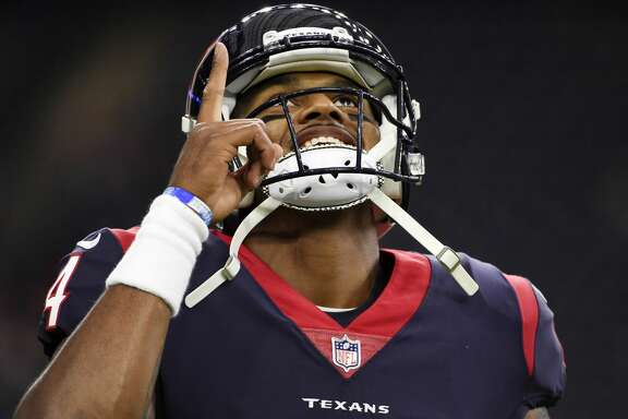 FILE - In this Sunday, Oct. 8, 2017, file photo, Houston Texans quarterback Deshaun Watson (4) warms up before an NFL football game against the Kansas City Chiefs in Houston. But while Watson has improved each week since taking over at halftime of the season opener, Cleveland's DeShone Kizer has struggled so much that the Brown benched him this week as they look to get their first win on Sunday at Houston. (AP Photo/Eric Christian Smith, File)
