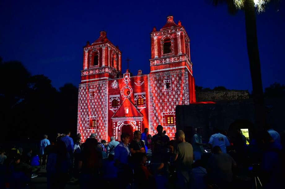 "Mission Concepcion is lit during the ""Restored by Light"" event, attended by more than 2,000 people. Photo: Robin Jerstad /San Antonio Express News / ROBERT JERSTAD"