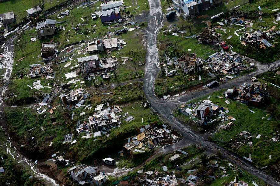 FILE - In this Thursday, Sept. 28, 2017 file photo, destroyed communities are seen in the aftermath of Hurricane Maria in Toa Alta, Puerto Rico. The House is on track to backing President Donald Trump's request for billions more in disaster aid, $16 billion to pay flood insurance claims and emergency funding to help the cash-strapped government of Puerto Rico stay afloat. The hurricane aid package Thursday, Oct. 12, 2017, totals $36.5 billion and sticks close to a White House request, ignoring - for now - huge demands from the powerful Florida and Texas delegations, who together pressed for some $40 billion more. (AP Photo/Gerald Herbert, File) Photo: Gerald Herbert, STF / Copyright 2017 The Associated Press. All rights reserved.
