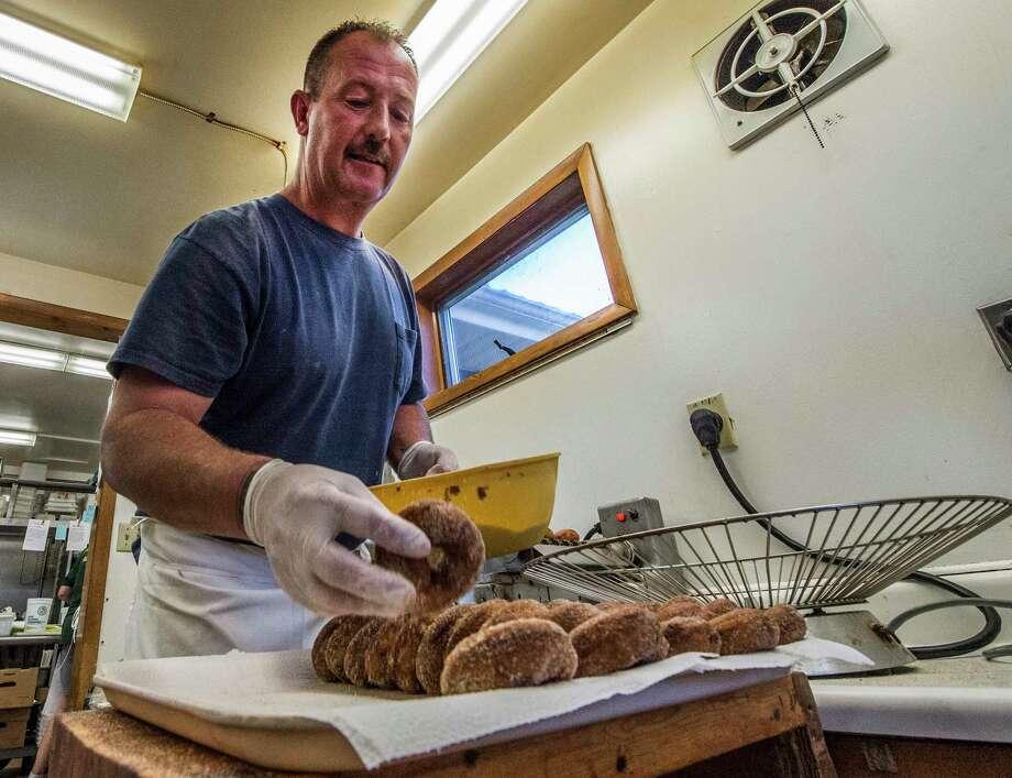 Richard Pearce makes cider doughnuts at the Lakeside Farms Tuesday Oct. 10, 2017 in Ballston Lake N.Y. (Skip Dickstein/Times Union) Photo: SKIP DICKSTEIN / 20041799A