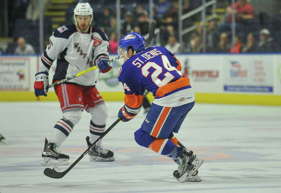 Travis St. Denis of the Sound Tigers carries the puck against the Hartford Wolf Pack on April 9 at Webster Bank Arena in Bridgeport. Photo: Gregory Vasil / For Hearst Connecticut Media / Connecticut Post Freelance
