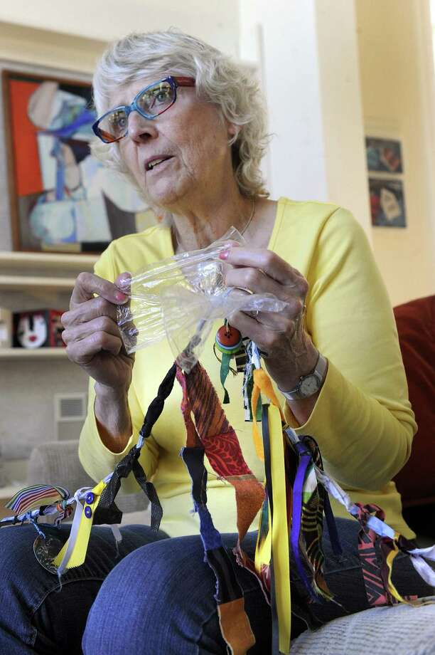 Marge Malwitz, explains a story rope, a creative art project she uses in her work with refugees, Thursday, Oct. 12, 2017. The plastic, for example, represents transparency. Photo: Carol Kaliff / Hearst Connecticut Media / The News-Times