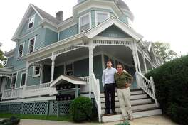 Maurice Nizzardo, center right, and son Cody Nizzardo pose in front of the blue Queen Anne-style house on Summer Street in Stamford, Conn. on Wednesday, Oct. 11, 2017. The old building now has offices on the first two floors and an apartment on the third.