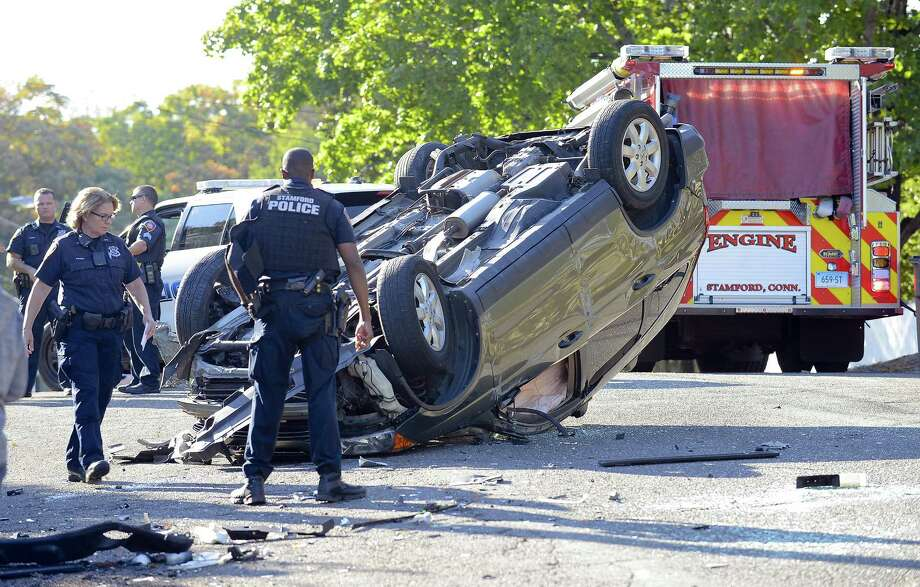 Stamford police investigate the scene of an accident on Old Barn Road South on Thursday, Oct. 12, 2017 in Stamford, Connecticut. Photo: Matthew Brown / Hearst Connecticut Media / Stamford Advocate