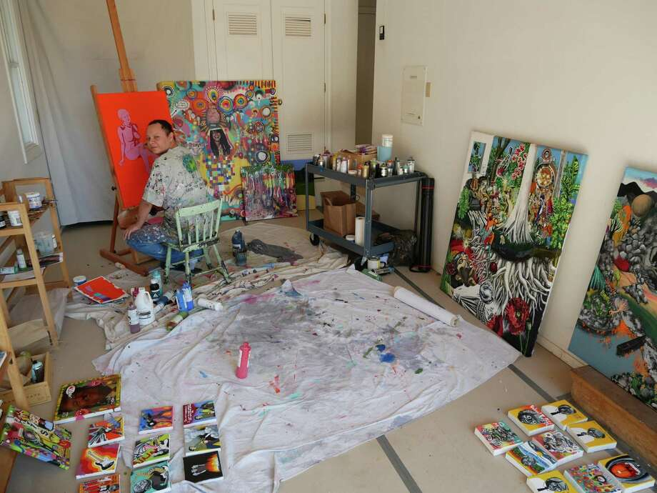 """Art Ventures Gallery's artist in residence Gerardo Gómez creating the artwork for the gallery's current exhibition, """"Summer of Love."""" Half of the exhibition's proceeds will be donated to relief efforts for the North Bay fires."""
