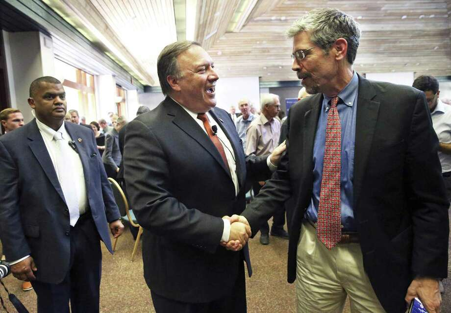 CIA Director Michael Pompeo greets New York Times reporter Eric Schmitt on Thursday after he delivers the keynote address to the National Security Forum being held in the Robert Strauss Center at the University of Texas. Pompeo criticized the publication during his address. Photo: Tom Reel /San Antonio Express-News / 2017 SAN ANTONIO EXPRESS-NEWS