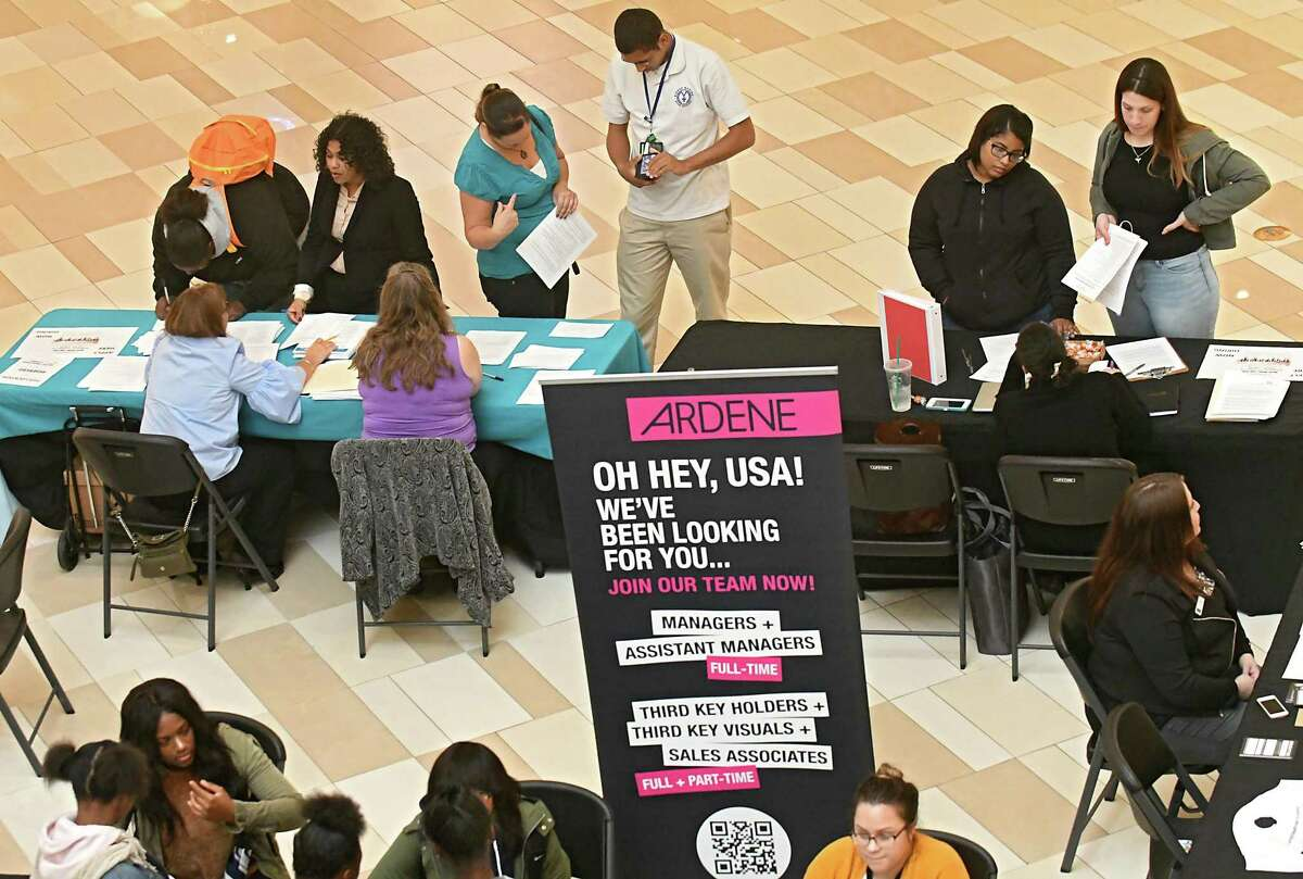 Job seekers talk to store representatives during a job fair at Crossgates Mall on Wednesday, Oct. 11, 2017 in Guilderland, N.Y. (Lori Van Buren / Times Union)