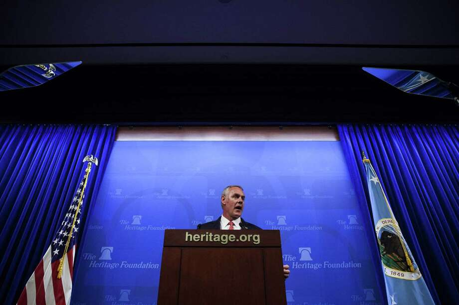 Interior Secretary Ryan Zinke speaks at the Heritage Foundation in Washington, D.C., in September. At right is his special secretarial flag. MUST CREDIT: Bloomberg photo by Zach Gibson Photo: Zach Gibson / Bloomberg