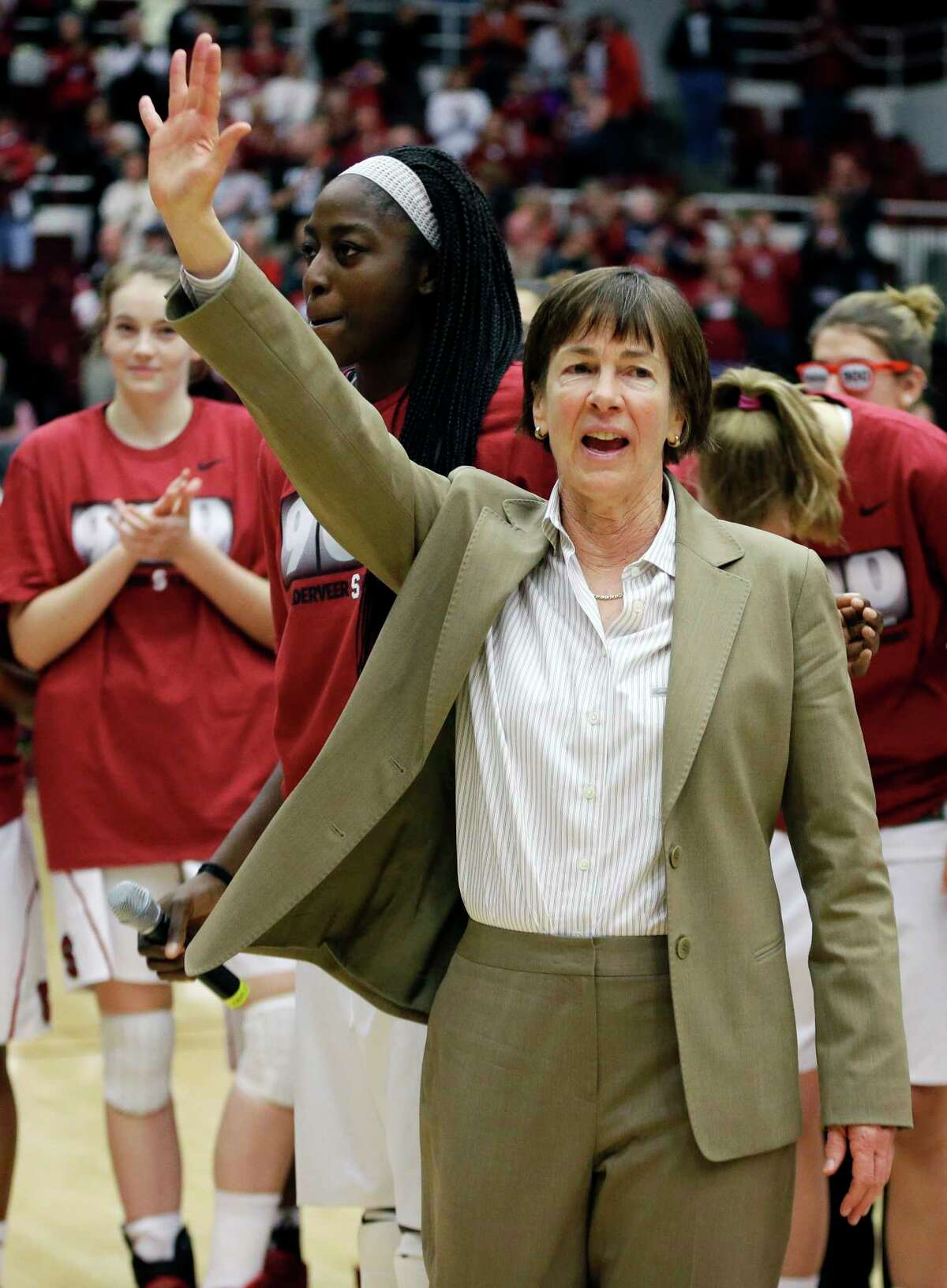 FILE - In this Dec. 14, 2013, file photo, Stanford coach Tara VanDerveer waves to fans after a ceremony in recognition of her 900 career wins, after the team's NCAA college basketball game against Gonzaga in Stanford, Calif. On Friday night when No. 8 Stanford hosts USC, Vanderveer is poised to become just the second NCAA women's coach to enter the 1,000 wins club, alongside the late Pat Summitt. (AP Photo/Ben Margot, File) ORG XMIT: FX202