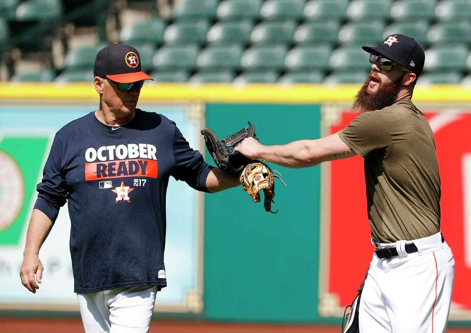 Houston Astros Dallas Keuchel the starting pitcher for the Game 1 of the ALCS chats with  first base coach Rich Dauer during workouts at Minute Maid Park, Thursday, Oct. 12, 2017, in Houston , ahead of Game 1 of the ALCS.  ( Karen Warren / Houston Chronicle ) Photo: Karen Warren, Staff / @ 2017 Houston Chronicle