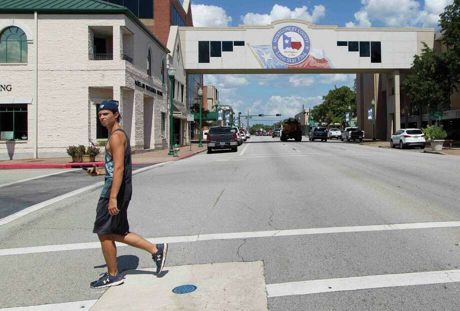 The city is planning the installation of new traffic signals at the intersections of Davis and Thompson streets and San Jacinto and Phillips streets. Photo: Jason Fochtman / Internal