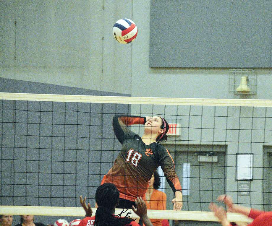 Edwardsville junior Corrine Timmermann goes up for a kill during the first game of Thursday's Southwestern Conference match at Alton.