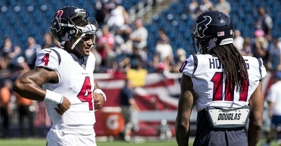 Houston Texans quarterback Deshaun Watson (4) and wide receiver DeAndre Hopkins (10) talk before Texans NFL football game againt the New England Patriots at Gillette Stadium on Sunday, Sept. 24, 2017, in Foxbourough, Mass. ( Brett Coomer / Houston Chronicle ) Photo: Brett Coomer/Houston Chronicle