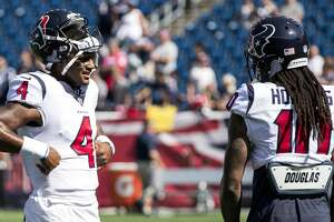 Houston Texans quarterback Deshaun Watson (4) and wide receiver DeAndre Hopkins (10) talk before Texans NFL football game againt the New England Patriots at Gillette Stadium on Sunday, Sept. 24, 2017, in Foxbourough, Mass. ( Brett Coomer / Houston Chronicle )