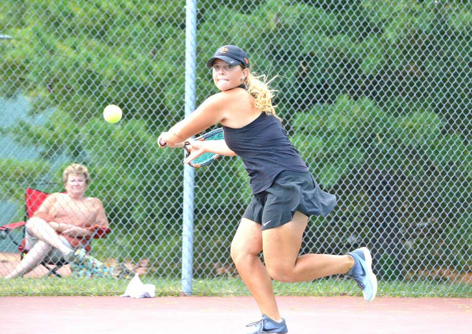 Edwardsville senior Mady Schreiber returns a shot during last week's Southwestern Conference Tournanent at the EHS Tennis Center.