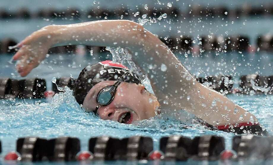 Cheshire's Grace Pettit wins the 500 yard freestyle in 5:24.56 against Amity, Thursday, Oct. 12, 2017, at the Cheshire Community Pool. Cheshire won, 101-82. Photo: Catherine Avalone, Hearst Connecticut Media / New Haven Register