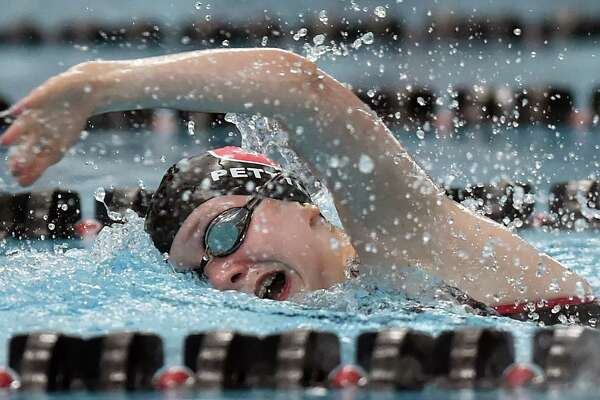 Cheshire's Grace Pettit wins the 500 yard freestyle in 5:24.56 against Amity, Thursday, Oct. 12, 2017, at the Cheshire Community Pool. Cheshire won, 101-82.